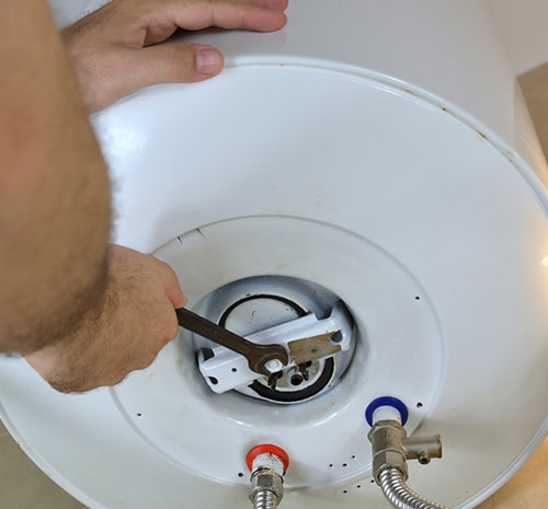 Water Heater With A Wrench On A Boiler — Hot Water Maintenance in Port Macquarie